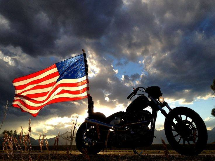 Motorcycle flying the American Flag