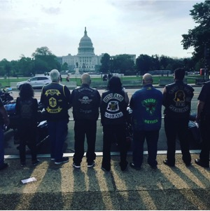 Motorcyclists stand in front of the Capitol Building in Washington, D.C.